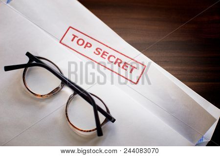 A Secret Document In An Envelope On The Desk. On The Sheet There Is An Inscription