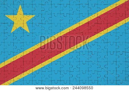 Democratic Republic Of The Congo Flag  Is Depicted On A Folded Puzzle