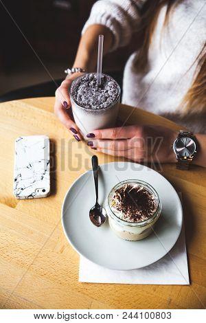 Milkshake In Plastic Cup On White Wooden Background