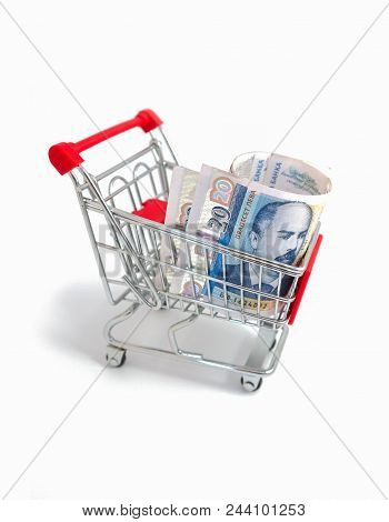Metal basket with a Bulgarian currency banknote, 20 leva inside. consumption. Shop store trolley with BGN, close up. Depicts a portraiture of Stefan Stambolov, famous Bulgarian politician. poster