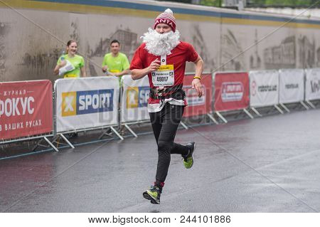 Dnipro, Ukraine - May 20, 2018: Santa Claus Running On The Central Street Of Dnipro City During Of T