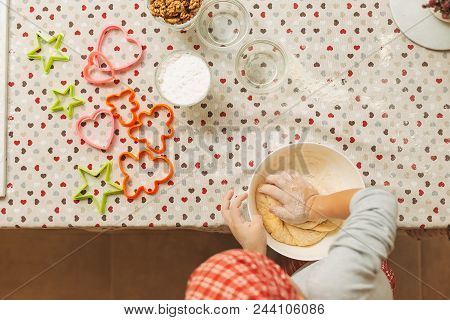 Cheerful Boy Making Dough For Biscuits. Child Making Cookies Using Baking Molds For Christmas Holida