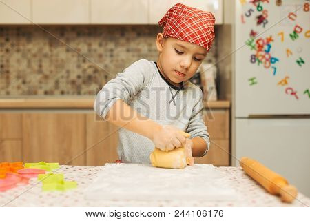 Cute Boy Making Dough For Biscuits. Child Making Cookies Using Baking Molds For Christmas Holidays I
