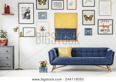 White, Artistic Living Room Interior With Colorful Furniture And Decorations. Real Photo Of A Navy B