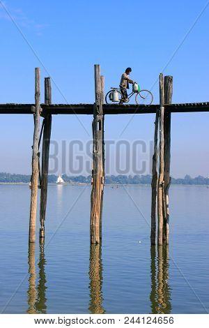 Amarapura, Myanmar - December 31: An Unidentified Man With A Bike Walks On U Bein Bridge On December