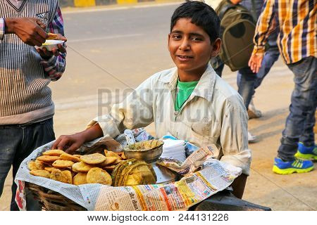 Agra, India - November 8: Unidentified Boy Sells Chaat (indian Snack) In Taj Ganj Neighborhood On No