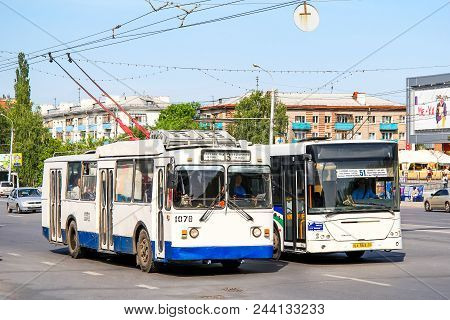 Ufa, Russia - May 25, 2012: Old Trolleybus Btz 5276-01 And City Bus Nefaz 52997 (vdl Transit) In The