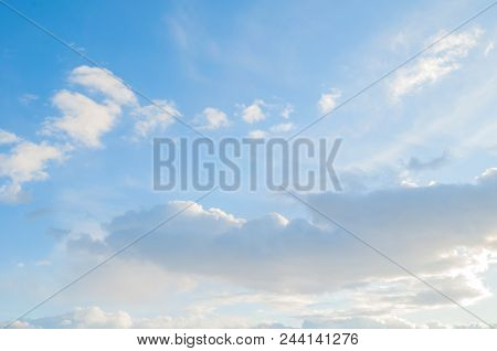 Blue Sky Sunrise Landscape With White Dramatic Sky Clouds. White Clouds In The Blue Sky - Colorful S