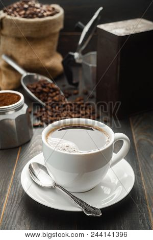 Coffee Cup, Coffee Beans With Bag, Scoop  And Coffee Maker Pot.