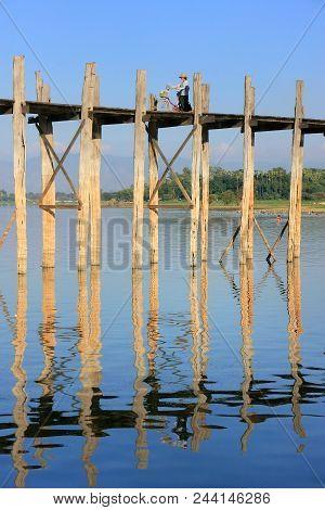 Amarapura, Myanmar - December 31: An Unidentified Woman With A Bike Walks On U Bein Bridge On Decemb