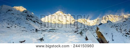 Panorama Of Snow And Mountain Range Landscape With Blue Sky From Annapurna Range, Nepal Himalayas.