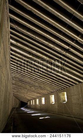 Dark road underground, long tunnel in the mountains.