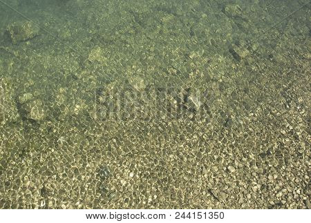 Glare And Ripples On Clear And Clear Water In A Clean Lake.