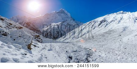 The Road In The Mountains Of Annapurna Range With Tourist On The Way, Nepal Himalayas. Travel Concep