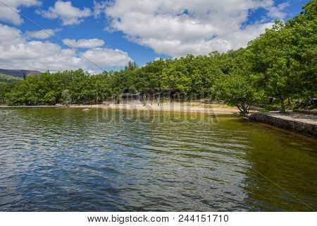 Lago de Sanabria, Spain - June 3, 2018: People at the lake de Sanabria, Castilla y Leon, Spain