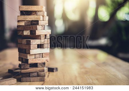 Wood Block On The Tower, Alternative Risk Concept, Plan And Strategy In Business, Risk To Make Busin