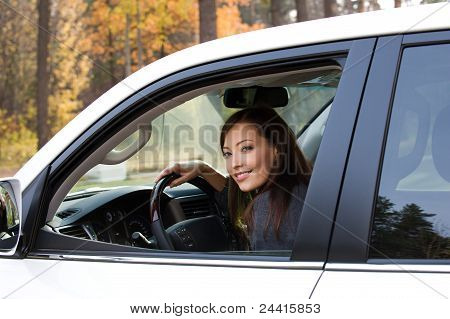 Smiling Woman Sits In The New Car