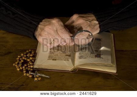 Old Hands With Bible And Rosary