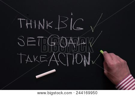 For Success Think Big, Then Set Goal And Necessarily Take Action. Man Writes On The Board The Rules