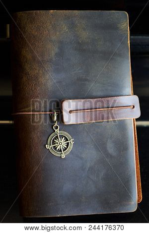 Travel Note On Black Background. Handmade Paper Diary Notebook In Brown Leather Cover. Old Vintage L