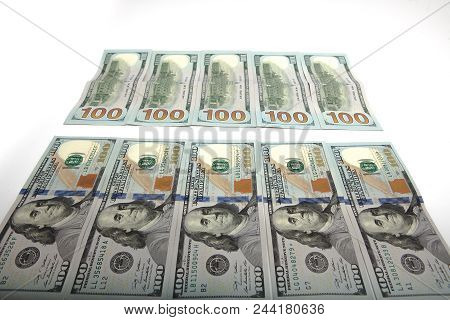 Large Surface Covered With Us Cash Notes.high Angle View Of Us Hundred Cash Notes Carefully Spread O
