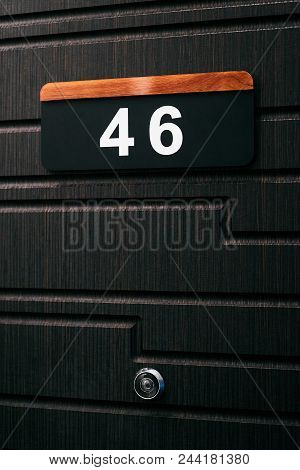House Number Forty Six 46 On Brown Wooden Door