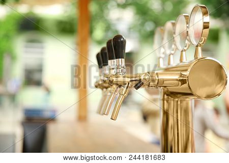 Bar Counter With Draft Beer Taps In Open-air Cafe