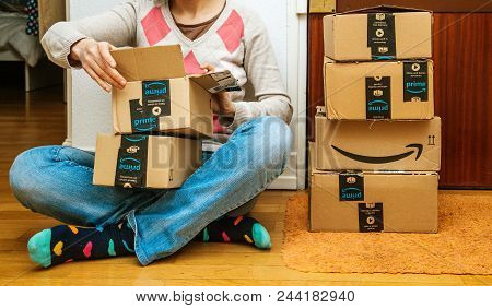 Paris, France - Jan 13, 2018: Stack Of Amazon Prime Packages Delivered To A Home Door Woman Unboxing