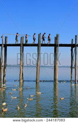 Amarapura, Myanmar - December 31: Unidentified Boys Walk On U Bein Bridge On December 31, 2011 In Am