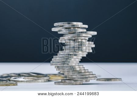 Unstable Closed To Collapse Stack Of Coins Tower , Uncertainty Of Business, Risk Of Financial Or Inv