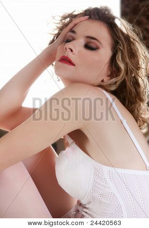 Young beautiful woman in white