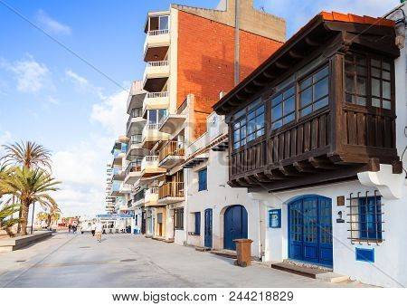 Calafell, Spain - August 14, 2014: People Walk On Coastal Street Of Calafell Town In Sunny Summer Da
