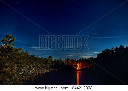 Lake With Campfire At Night Starry Sky
