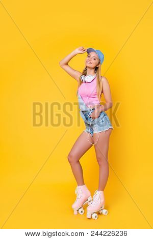 Full Body, Size Portrait Of Slim Fit Sporty Active Girl In Denim Overall With Headset On Neck Holdin