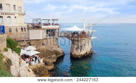 Nice, France - 02 June, 2018: People In Enjoying The View In Le Plongeoir. The Bar And Restaurant In