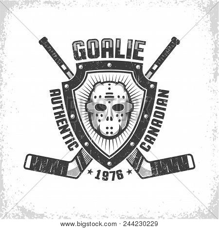 Emblem With Canadian Hockey Retro Mask On Triangular Shield On Background Of Crossed Goalies. Worn T