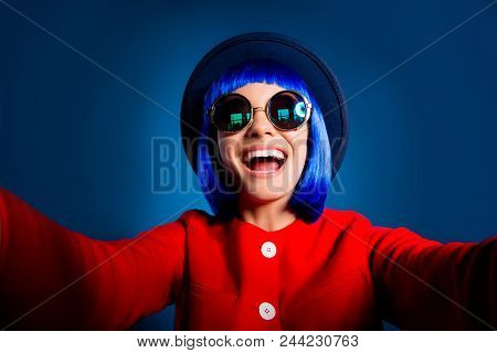 Self Portrait Of Cheerful Positive Woman With Beaming Smile Shooting Selfie On Front Camera With Two