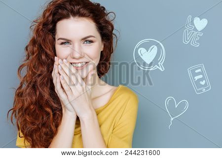 Romantic Mood. Young Beautiful Woman Having A Romantic Mood And Kindly Smiling While Dreaming About