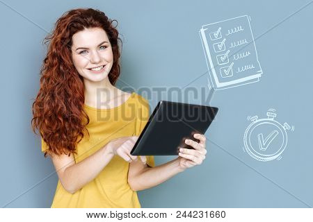 Busy Timetable. Enthusiastic Busy Accountant Smiling And Standing With A Modern Tablet While Checkin