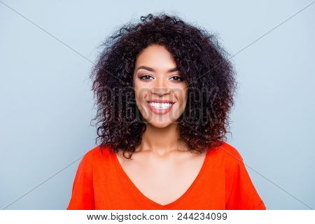 Portrait Of Cheerful Joyful Woman In Orange Outfit With White Smile Plump Lips Looking At Camera Iso