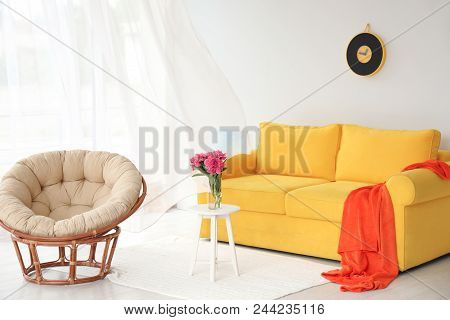 Elegant Living Room Interior With Comfortable Sofa And Papasan Chair