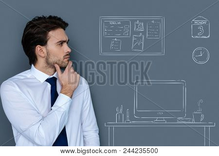 Thoughtful Young Man. Attentive Young Programmer Thoughtfully Touching His Chin While Looking At His