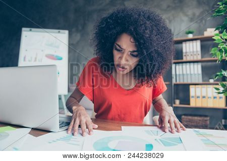 Portrait Of Serious Worried Woman Expertising Documents With Diagrams Finding Mistake Having Bad Res