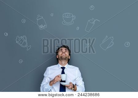 Pleasant Lunch Time. Cheerful Emotional Manager Looking Happy While Drinking Coffee During His Free