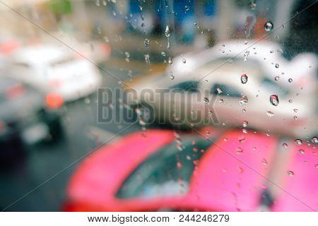 Rain Drops On Car Window With Road Light Bokeh. Stock Image Of Rain Drops On Car Glass In Rainy Seas
