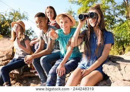 Group Of Children With Binoculars Outdoors. Summer Camp