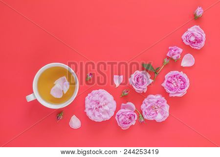 Cup Of Tea With Pink Roses Flower Bouquet On Pink Red Background