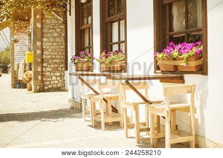 Berat, Albania - June 2018: Cozy Street Cafe In Historical Town Berat, Ottoman Architecture In Alban
