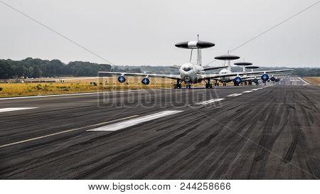 Geilenkirchen, Germany - Jul 2, 2017: Line Of Nato Boeing E-3 Sentry Awacs Radar Planes On The Runwa