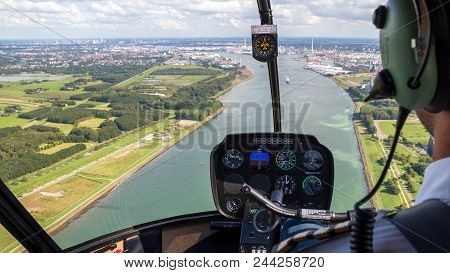 Helicopter Flight. View From The Cockpit With The Pilot And Flight Instruments.